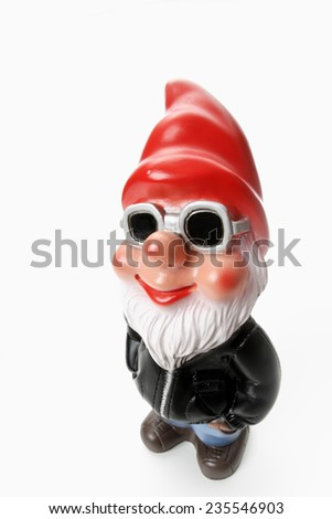 Cool garden gnome wearing sun glasses - stock photo