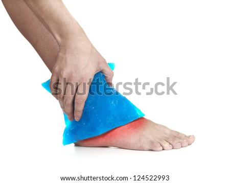 Cool gel pack on a swollen hurting ankle. Medical concept photo. Isolation on a white background. Color Enhanced skin with read spot indicating location of the pain. - stock photo