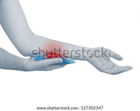 Cool gel pack on a swollen hurting hand. Medical concept photo. Isolation on a white background. Color Enhanced skin with read spot indicating location of the pain. - stock photo