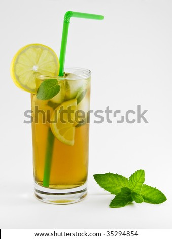 Cool green tea with lemon and fresh mint - stock photo