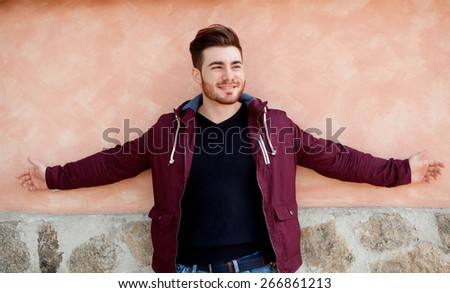 Cool handsome guy with the arms stretched - stock photo