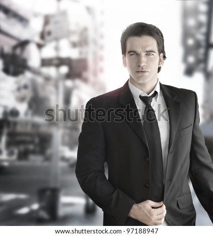 Cool handsome young male model walking - stock photo