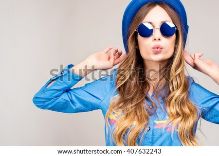 Cool hipster student woman wearing eyewear glasses . Caucasian female university student looking at camera smiling happy. - stock photo