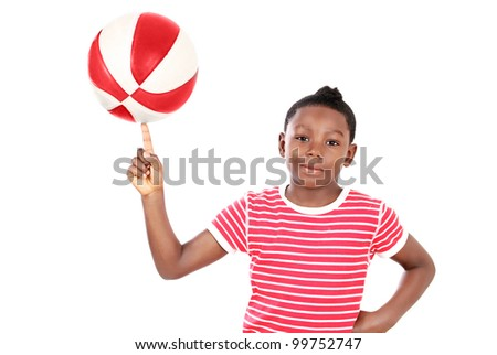 Cool kid with ball finger balancing fun - stock photo