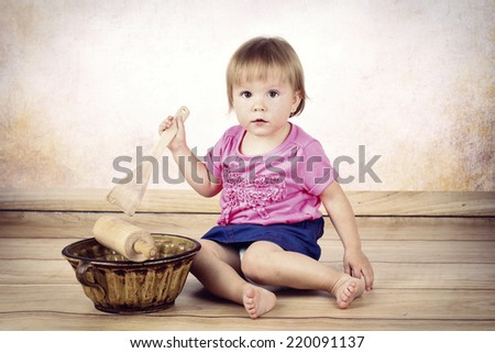 Cool little girl cooking - stock photo