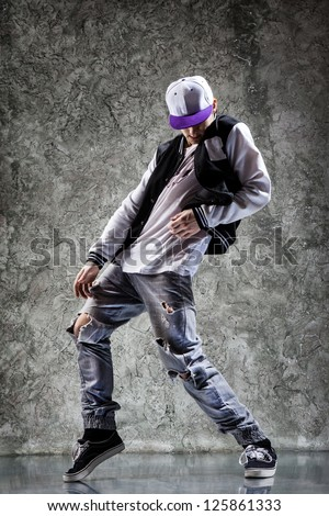 cool looking and stylishly dressed dancer posing - stock photo