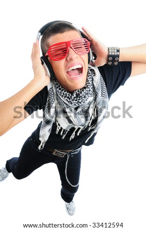 Cool looking guy listening to music and having fun view from above - stock photo