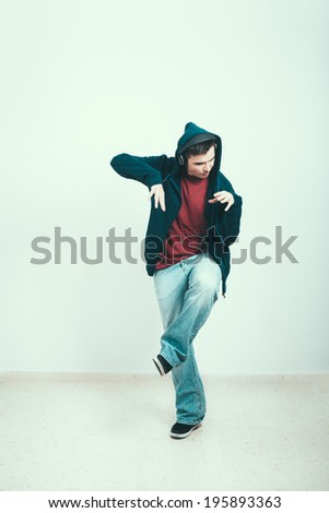Cool man in hoodie dancing. - stock photo
