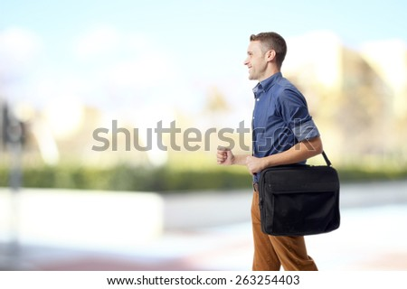 cool man walking with computer briefcase - stock photo