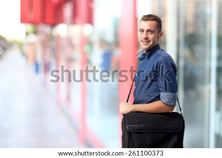 cool man with computer briefcase - stock photo