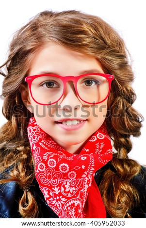 Cool modern girl teenager wearing stylish clothing. Fashion for children. Studio shot. Isolated over white. - stock photo