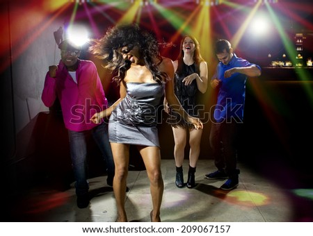 cool people dancing in a nightclub or bar lounge - stock photo