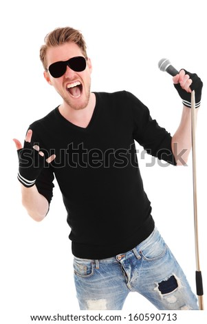 Cool rocker in sunglasses wearing a black shirt holding a mic stand with a microphone. White background. - stock photo