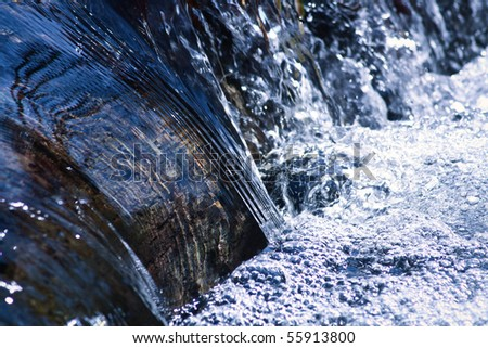 cool rushing water in natural stream - stock photo