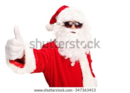 Cool Santa with black sunglasses giving a thumb up and looking at the camera isolated on white background - stock photo
