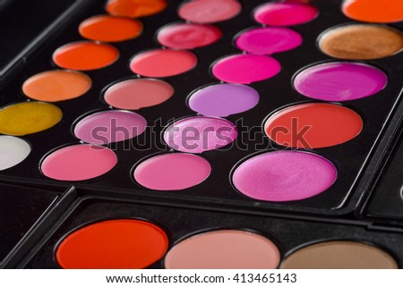Cool set for making seductive lips look flawless. Juicy rich gradation of girlish colors for interesting and catchy make-up. The assortment of red and pink tints. - stock photo