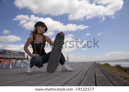 cool skateboard woman in outdoor - stock photo