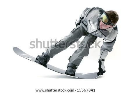 Cool snowboarder flexing the board - stock photo