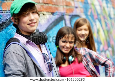 Cool teenagers hanging out together outdoors - stock photo