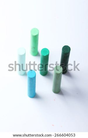 cool tone colorful chalk pastels on white background - stock photo