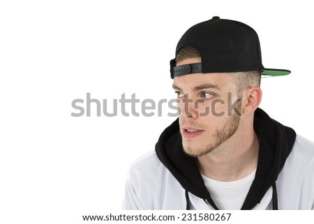 Cool Trendy Styling Fashionable white male wearing blue jeans, black hat / cap and white and black baseball jacket  - stock photo