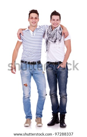 Cool two friends guys standing with hands on shoulders and looking at you isolated on white background - stock photo