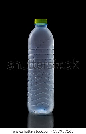 cool water in plastic bottle isolate on black - stock photo