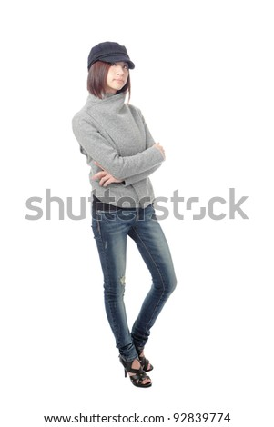 Cool young girl with blue jeans isolated on white background, model is a asian beauty - stock photo