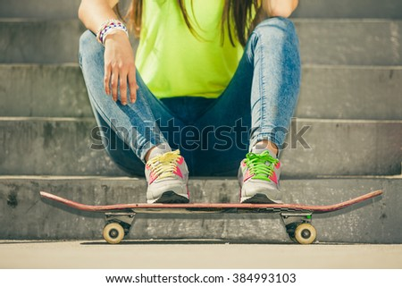 Cool young girl with skateboard sitting on the urban stairs. Active lifestyle funky in summer. Trendy sport teen. - stock photo