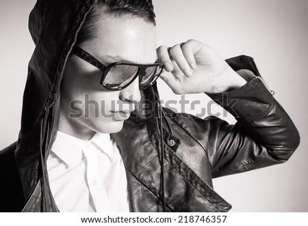 Cool young male model posing. Fashion studio shoot - stock photo