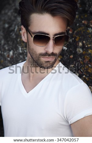 Cool young man wearing white and sunglasses - stock photo