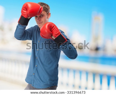 cool young-man with boxing-gloves - stock photo