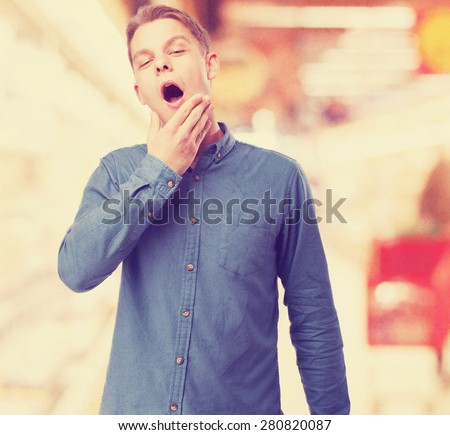 cool young-man yawning - stock photo