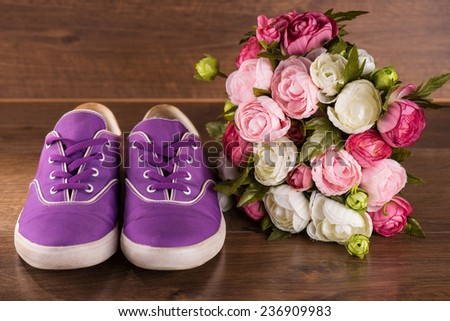 cool youth violet   shoes near bunch of roses on brown parquet  wooden floor   - stock photo