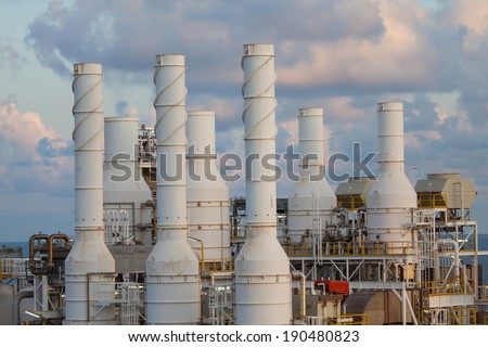Cooling tower of oil and gas plant, hot gas from the process was cooling as the process, The line as same as the exhaust of turbine system, Do not touch the hot surface  - stock photo