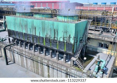 Cooling towers at an sewage treatment plant - stock photo