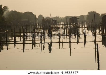 Coop, fisherman lifestyle on sunrise at Thailand - stock photo