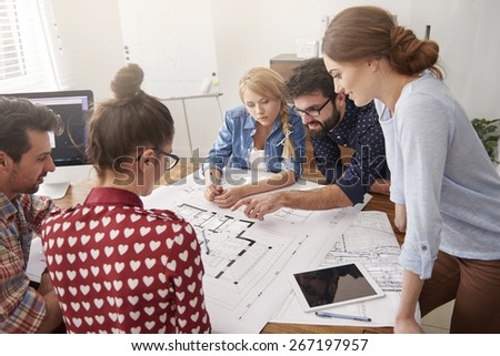 Cooperating with young and creative team - stock photo