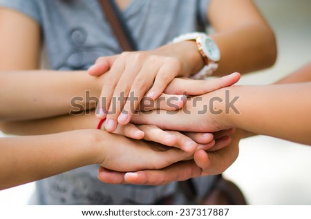 cooperation and team work fight difficulty - stock photo