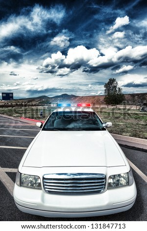 cop car with special photographic processing - stock photo