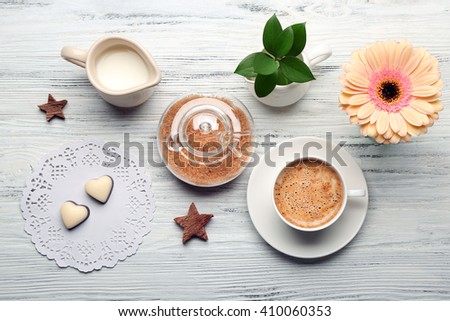 Cop of coffee and brown sugar on wooden table, top view - stock photo