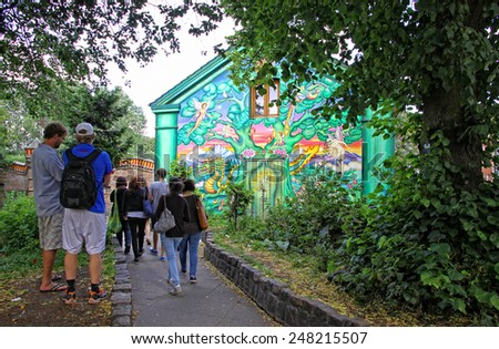 COPENHAGEN, DENMARK - JULY 28, 2012: Christiania, also known as Freetown Christiania is a self-proclaimed autonomous neighbourhood, covering 34 hectares in the borough of Christianshavn in Copenhagen - stock photo