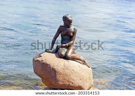 COPENHAGEN, DENMARK - JULY 2: The Little Mermaid statue on July 2, 2014 in Copenhagen - stock photo