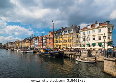 COPENHAGEN, DENMARK - JUNE 06, 2015: People enjoy a sunny day in the Nyhavn district in the Danish capital city, Copenhagen. - stock photo
