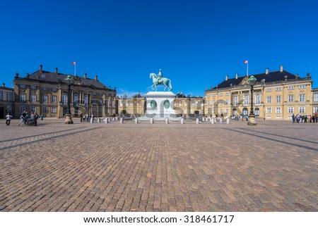 COPENHAGEN, DENMARK - JUNE 05, 2015: People visit the Amelienborg Palace in the Danish capital city Copenhagen. It is a residence of the Danish royal family. - stock photo