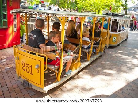 COPENHAGEN, DENMARK - JUNE 30:  Tivoli Trolley Bus on June 30, 2014 in Copenhagen - stock photo