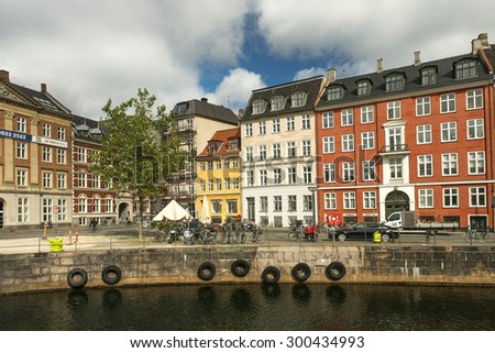 COPENHAGEN, DENMARK - Juny 26: waterfront of the Old Town, with its colourful buildings, Copenhagen on Juny 26, 2015 Copenhagen - capital and largest city of Denmark - stock photo