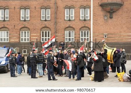COPENHAGEN, DENMARK - MARCH 18: Demonstration in support of Bashar al-Assad in Syria on City Hall Square on March 18, 2012 in Copenhagen, Denmark - stock photo