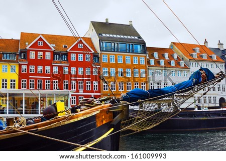 Copenhagen, Denmark. Yacht and color houses in seafront Nyhavn. - stock photo