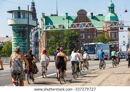 Copenhagen is one of the most bicycle friendly cities in the World.  Copenhagen, Denmark in a summer day - stock photo
